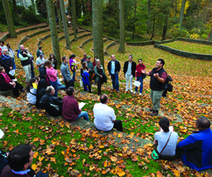 José-Luis Machado, an associate professor of biology who conducts research with students in the Crum Woods, leads parents, students, and alumni on a woods tour during Garnet Homecoming and Family Weekend in October.
