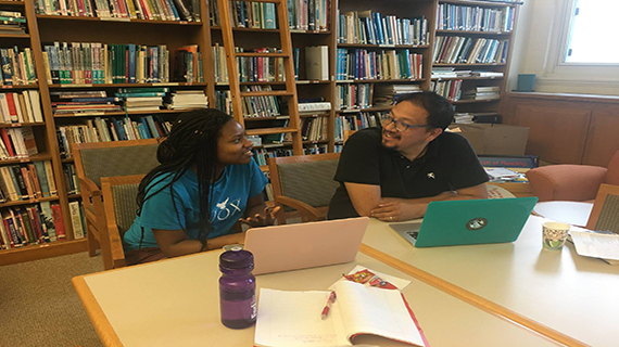 Professor Edwin Mayorga working with student