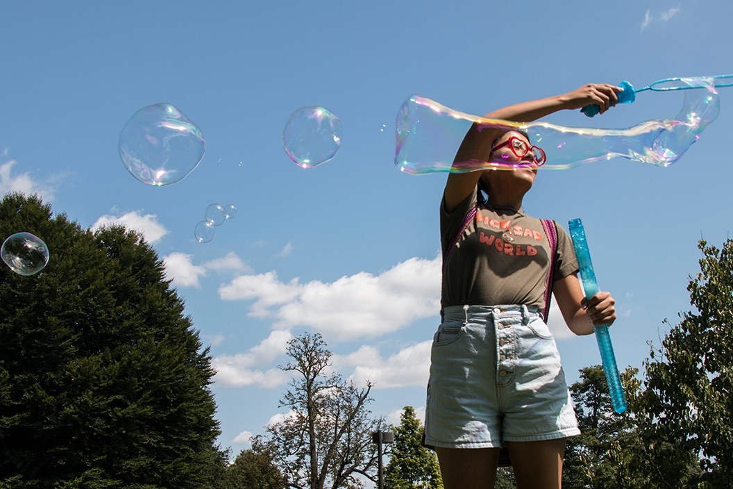 student making bubbles