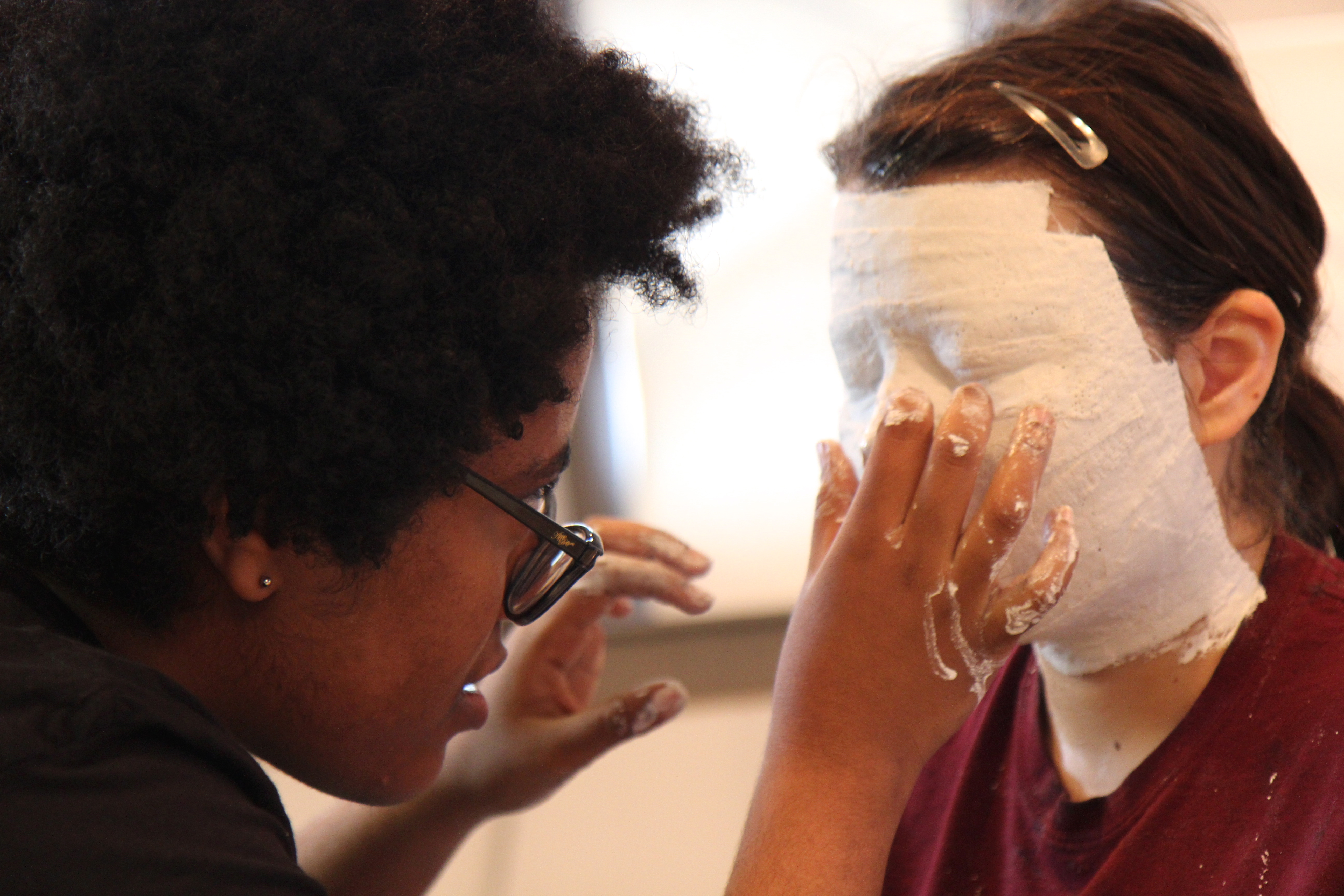 Swarthmore Sculpture students create plaster face molds.
