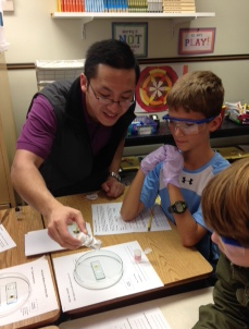 Martin Mathay '15 with 5th graders at a nearby elementary school.