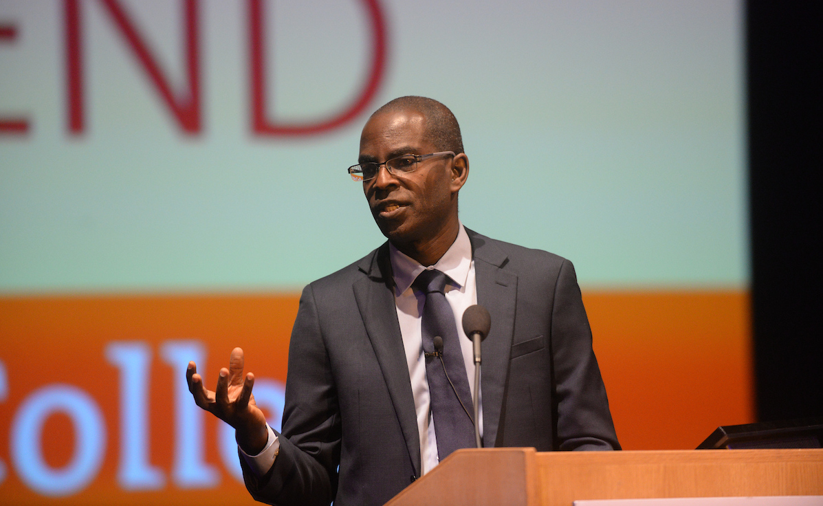 Patrick Awuah '89, founder and president of Ashesi University, talks behind a wooden lectern at the 2016 McCabe Lecture