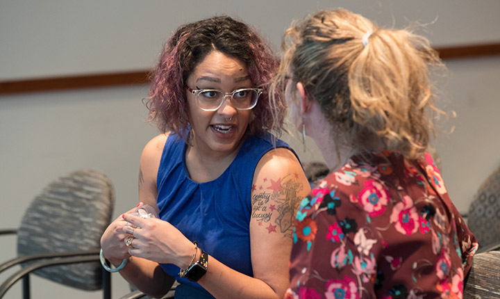 Eve Ewing speaks with a student