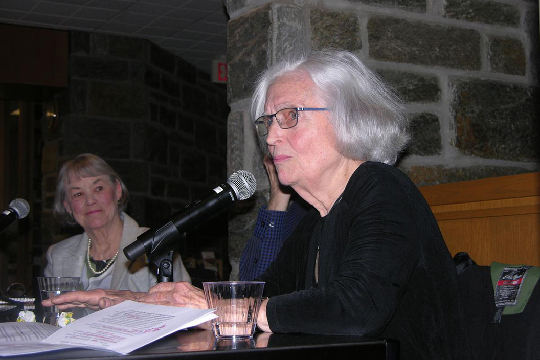Betty Medsger sitting at table with microphone