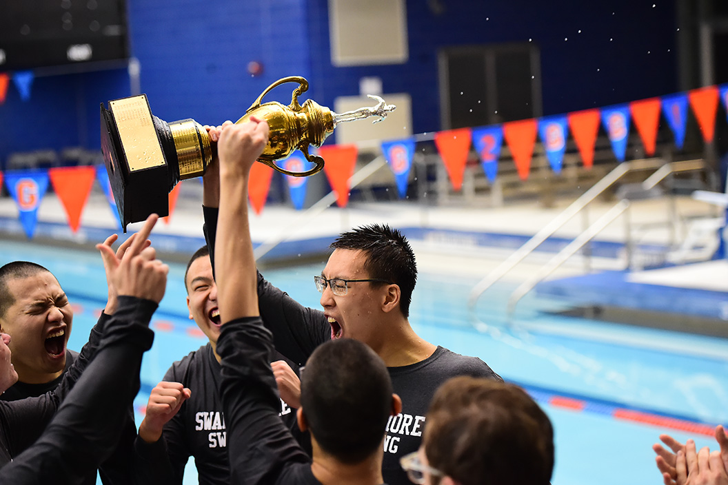 Members of swim team with trophy