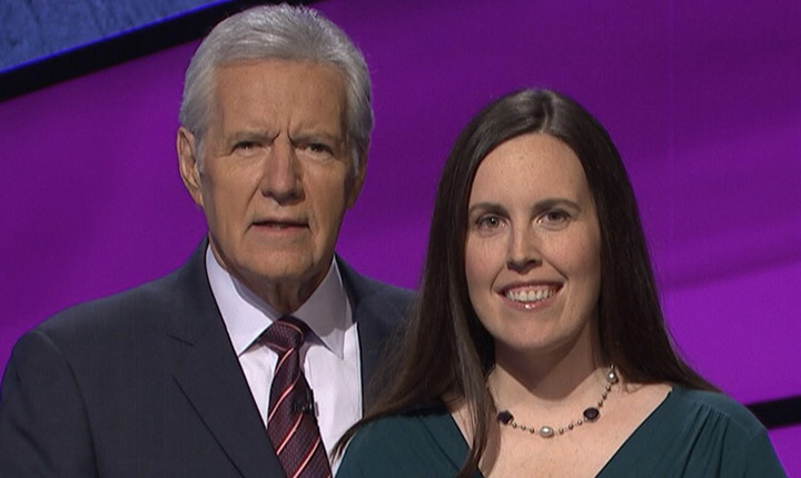 Alex Trebek stands with Emily Frey