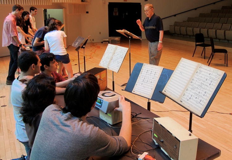 James Freemon conducts an orchestra during rehearsal