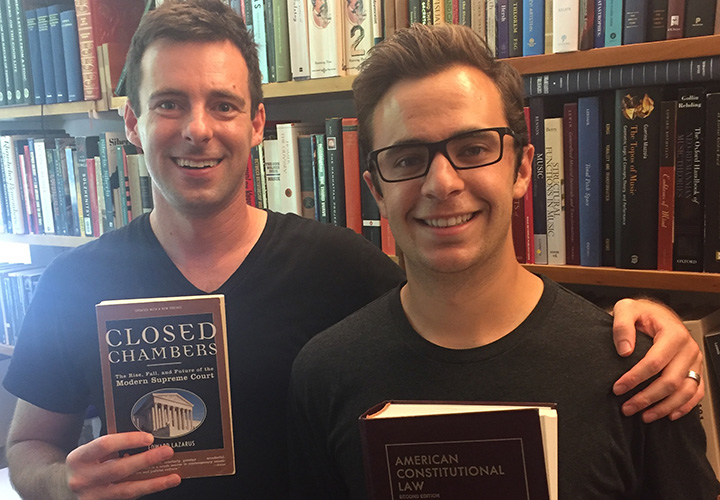 Noah Giansiracusa and Cameron Ricciardi pose with law books