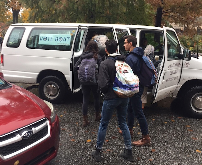 Students get into van to go to polls