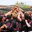 Baseball team holds conference trophy