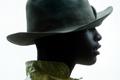 A 14-year-old boy wears a worn felt hat during a trail ride south of Austin, Texas.