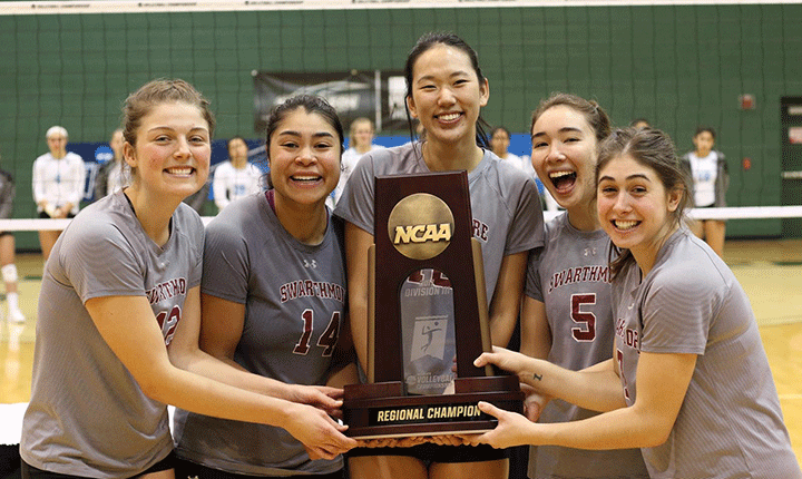 Members of the Swarthmore Volleyball team pose for a photo with the regional championship trophy