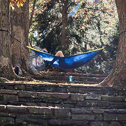 student in hammock on ampitheater