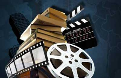 Film reels, books, and film clapperboard