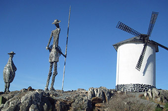 Don Quijote statues standing near windmill