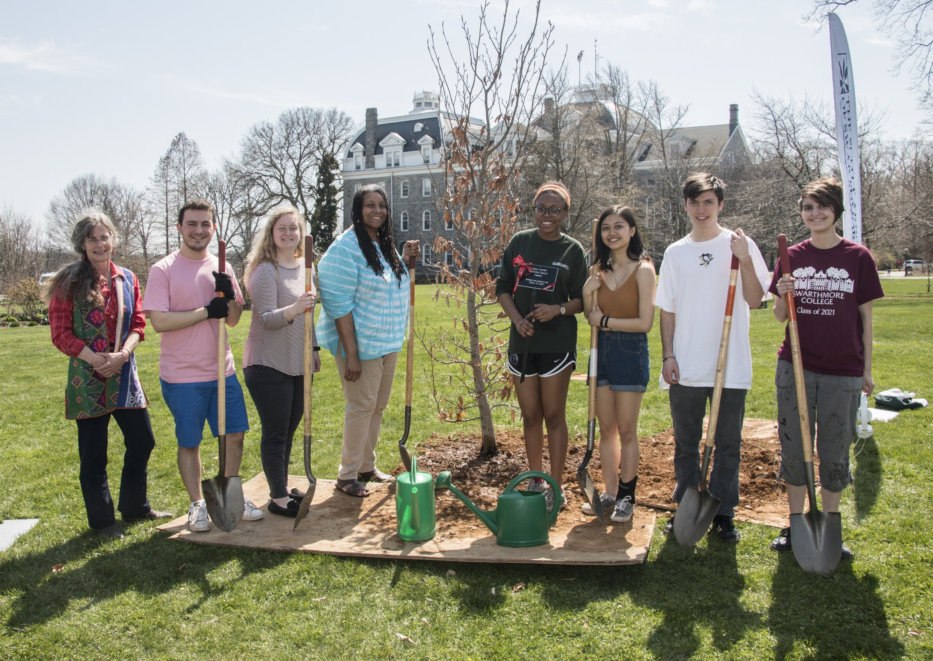 Students pose with staff after planting their class tree!
