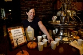 Apple Cider is served at the 2012 Harvest Dinner