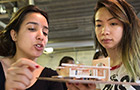 Two students look at their 3-D model