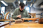 Student does woodworking in maker space