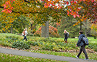 Students walk on campus on a fall day