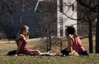 Students sitting on Parrish Beach
