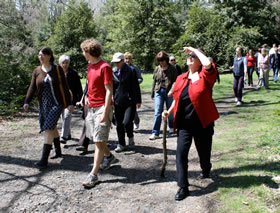 A group of faculty and staff on a walk on one of the multiple walkways available on campus.  Download the trail map pdf