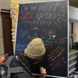 A student writes on a chalkboard
