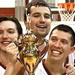 Three players with trophy