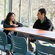 two students talking in renovated willets lounge