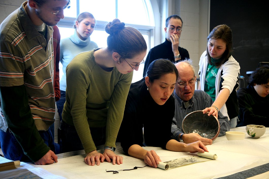 Professor discussing Japanese ceramics with students