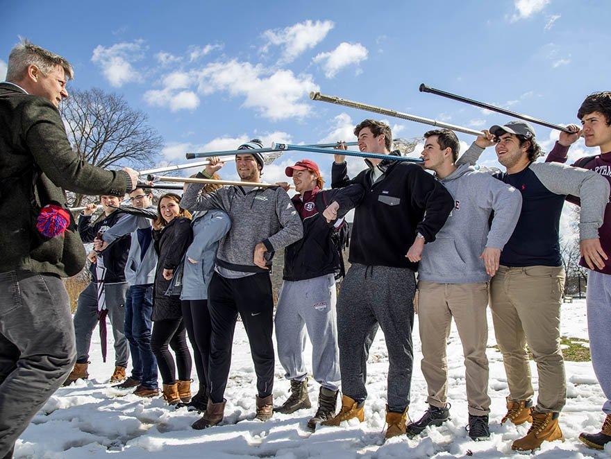 faculty and students reenacting ancient warfare
