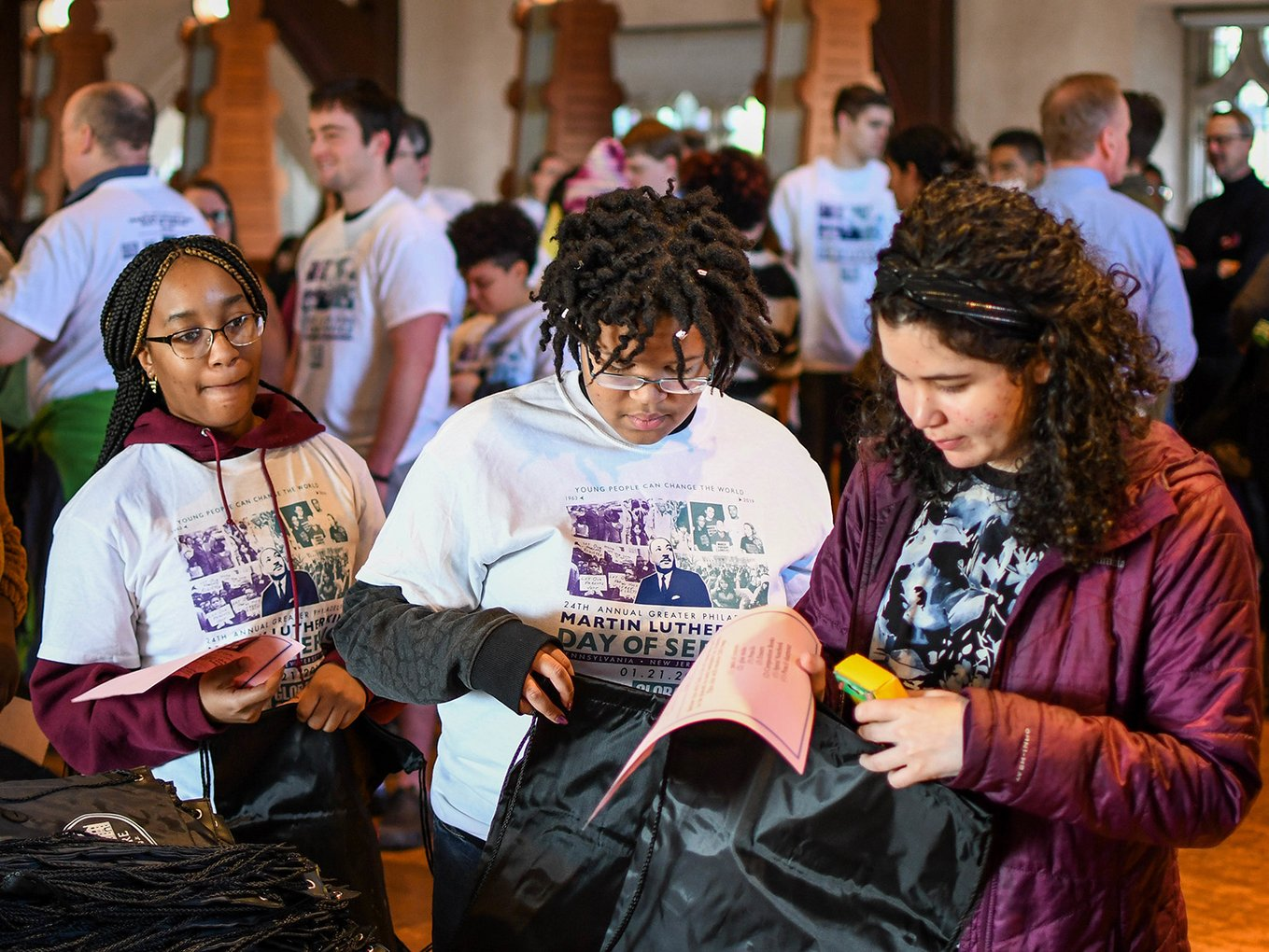 Students pack bag for MLK Service Day project