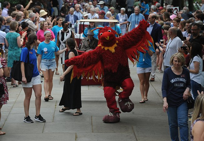 Phineas the Phoenix leads the Parade of Classes