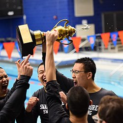 Men's swim team with trophy