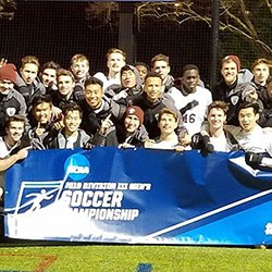 Swarthmore men's soccer team poses with NCAA banner