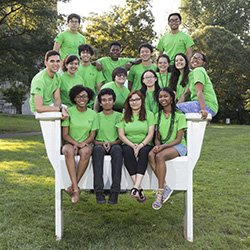 Summer scholars pose for group photo in big chair