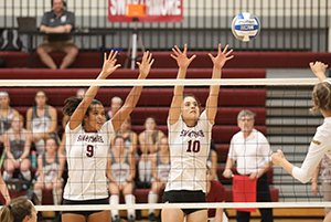 Emma Morgan-Bennett and Mehra den Braven trying to block across from volleyball net
