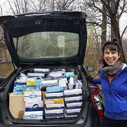 Melanie Leeds with car trunk full of PPEs for healthcare workers.