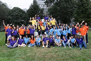 Students in group photo on lawn