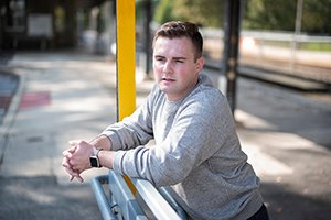 Liam Santry outdoors, leaning on a rail