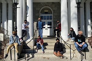 Students sitting outdoors on steps of Parrish Hall
