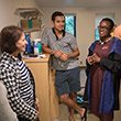 President Valerie Smith talks to a student and his family in his dorm on move-in day