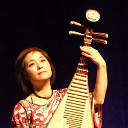 Wu Man plays pipa on stage