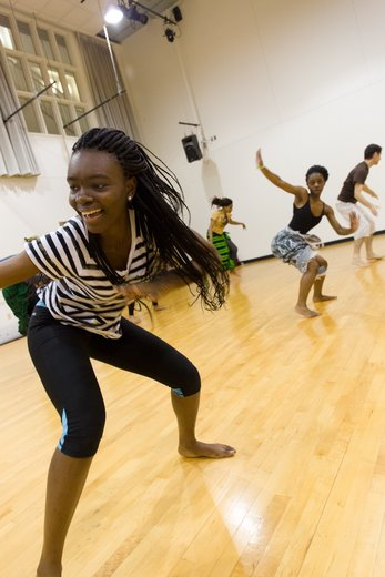 dancers in rehearse African steps