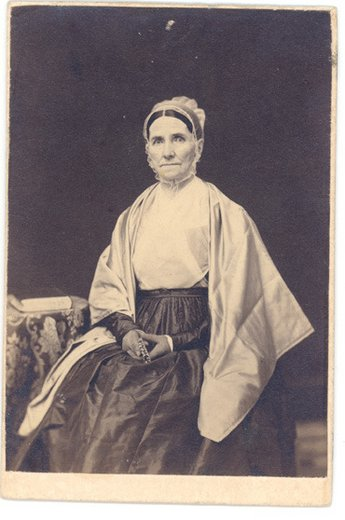 Photo of Ann Abbot by E. Woodward in Quaker dress from Drueilla R. Thomas's album