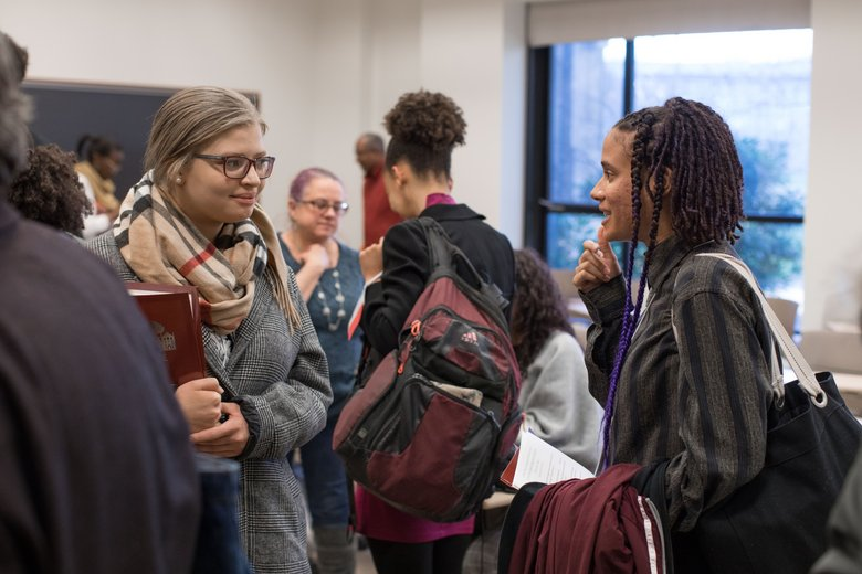 Leslie Moreaux '20 speaks with another attendee at the 2019 Mid-Atlantic Regional Conference.