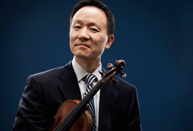 David Kim holding his violin under his arm