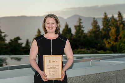 Aurora Winslade holding the Sustainability Award