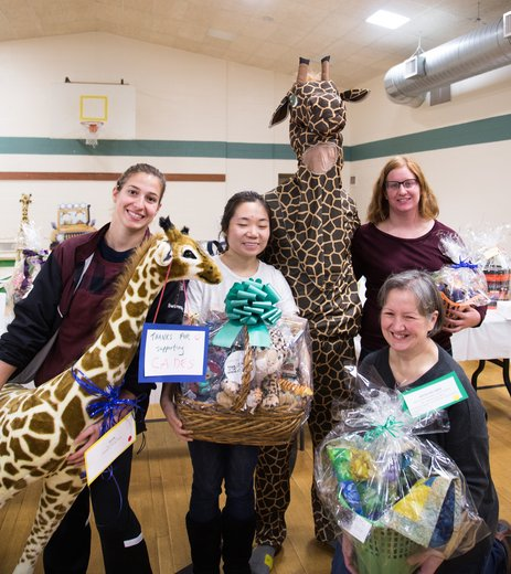 Sarah Solomon '19, Runa (Yan) Cheng '20, Kyle Campbell '19 (dressed as a giraffe), and local volunteers helped to organize Putt Putt Palooza in support of the CADES school.