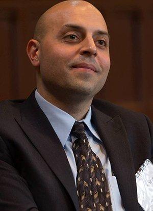 Sa'ed Atshan in suit jacket and tie, smiling